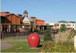 Enjoy Restaurant and Legacy Park with apple sculptures