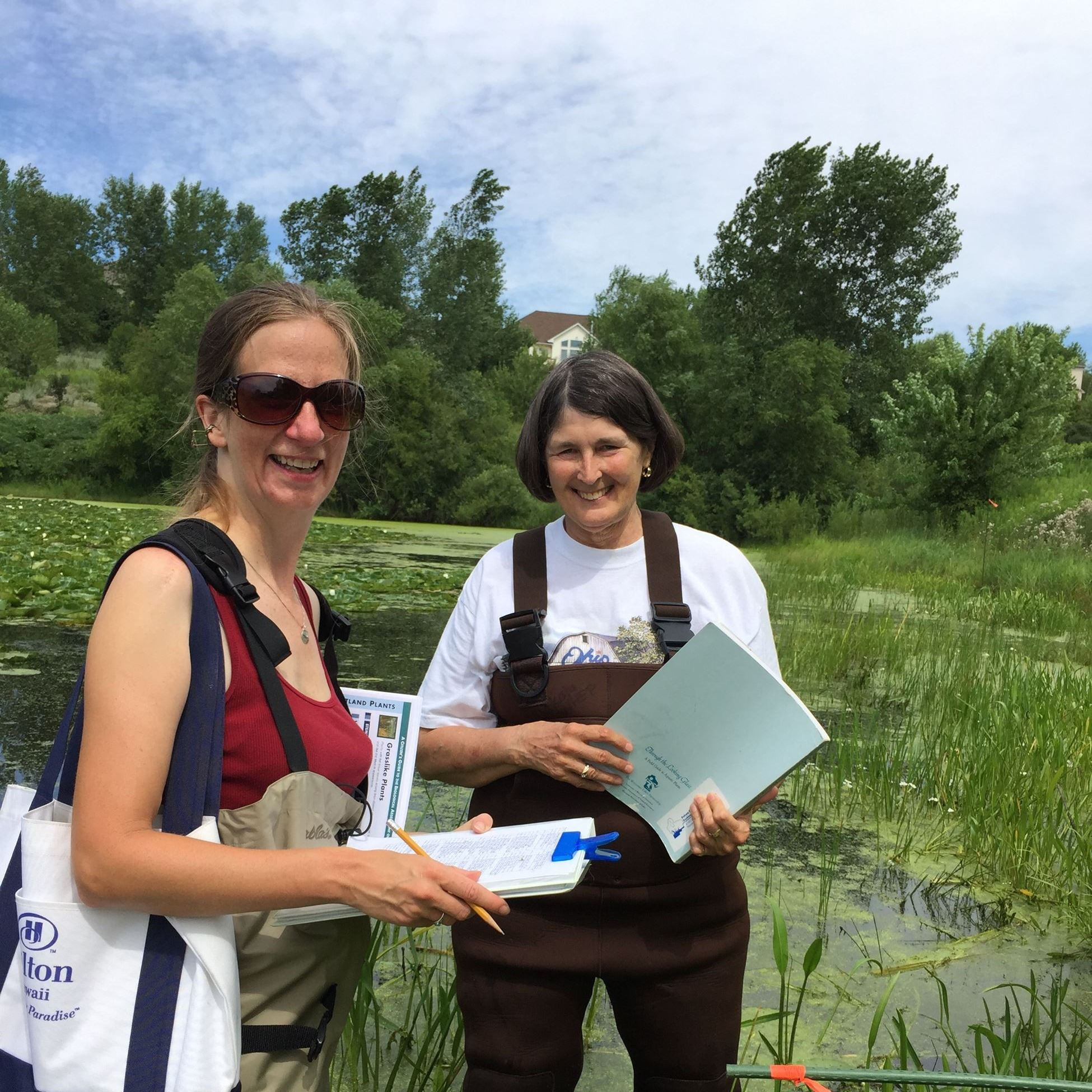 Two volunteers monitor wetlands for WHEP
