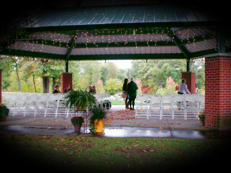 gazebo set up with lights and chairs for outdoor ceremony