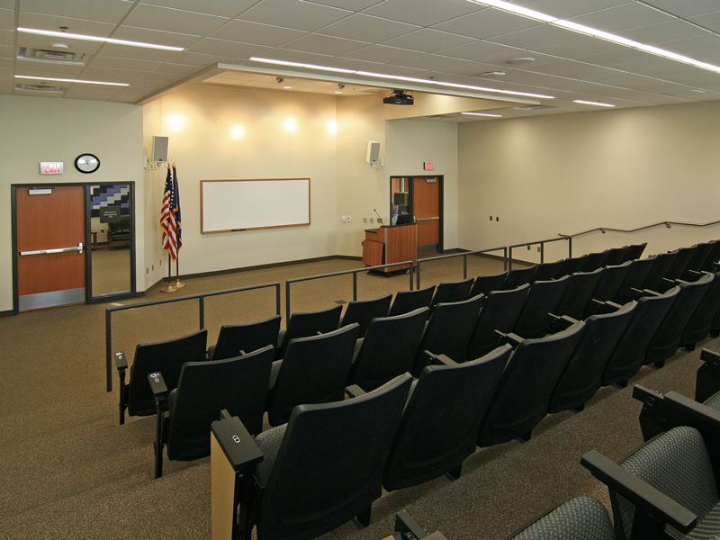 Theater seating and presentation area with podium and white board